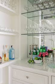 bar cabinet with mirrored backsplash