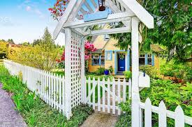 Small Yellow House Exterior With White Picket Fence Stock Photo Download Image Now Istock