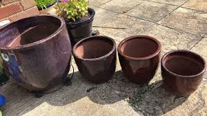 garden ceramic pots red and purple in