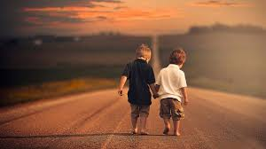 two friends walking down the road