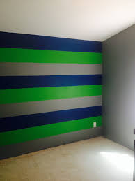Just Painted My 14 Yr Old Son S Room Seattle Seahawks Colors Sparkling Apple Behr Royal Breeze Behr Boys Bedroom Colors Boys Bedroom Green Boy Room Paint