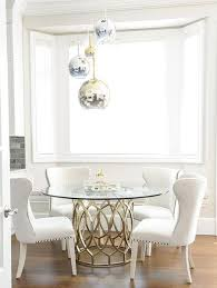 opting for a glass top dining table