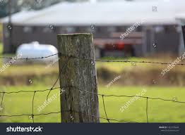 Old Barbed Wire Fence Post Closeup Stock Photo Edit Now 1522170644