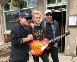 Young guitarist meets Mark Knopfler and Brian Johnson and plays their riffs  for them - Chronicle Live