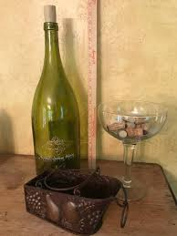 oversized wine bottle and glass with