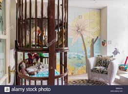 Bunk Bed With Shelf In Kids Bedroom With Armchair And Mural Stock Photo Alamy