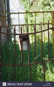 Mailbox Hanging On Wrought Iron Fence Stock Photo Alamy