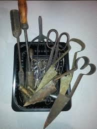 box of vintage garden and farm tools