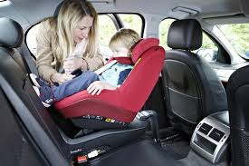 strap your child into their car seat