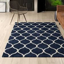 duhon geometric navy ivory area rug