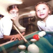 Jennifer Avina, left, and Ashley Castillo play bumper pool at the Boys &  Girls Club in Guadalupe.     santamariatimes.com