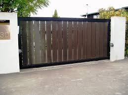 17 Irresistible Wooden Gate Designs To Adorn Your Exterior Wooden Gate Designs Fence Design Contemporary Gates