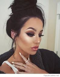 top bun and glam makeup