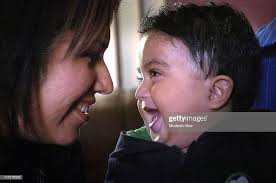 Jose and Carolina Alfaro smiles at 16-month-old son Adrian, May 20 at...  News Photo - Getty Images