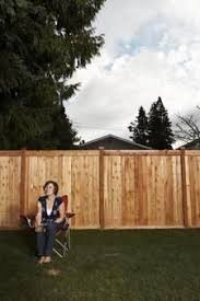 Home Exterior How To Fill Gaps Under A Wood Fence Diy Guides Living Wikii Building A Fence Wooden Fence Fence Design