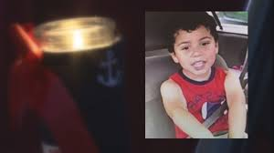 Vigil held for NC boy after body found in pond