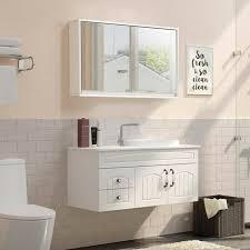 bathroom wall cabinet between mirrors