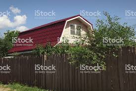 Small Country House Behind A High Fence Stock Photo Download Image Now Istock