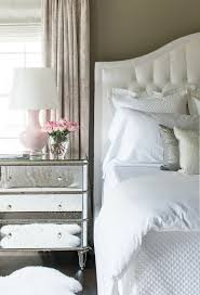 white tufted headboard pink table light
