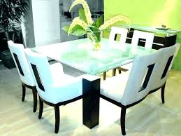 le glass top dining table