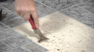how to remove vinyl tiles adhesive