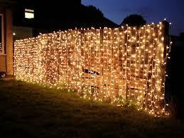 15 Fantastic Ideas For Decorating Your Garden Fence Curtain Lights Fairy Lights Summer Garden