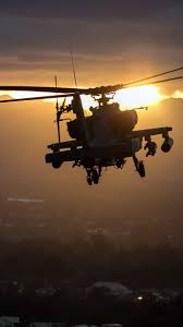 apache ah 64 helicopter flight sunset