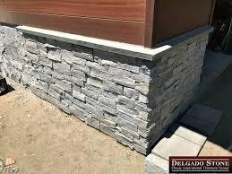 can you put stone veneer over brick