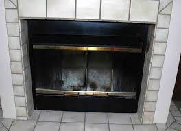 replacing glass doors on a fireplace