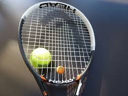 white and black head tennis racket