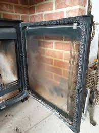 how to clean wood burning stove glass