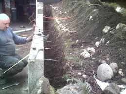 retaining wall repair leaning