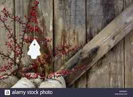 Christmas Decor Hanging From Plant Against Wooden Fence Stock Photo Alamy