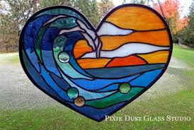 stained glass window surf s up at