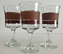 clear red brown striped wine glasses