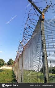 Sharp Barbed Wire On Security Fence Protection Secure Private Space Stock Photo C Thamkc 154780726