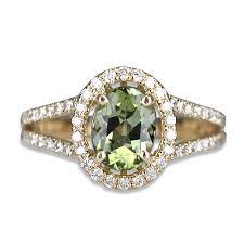 green tourmaline ring with diamonds set