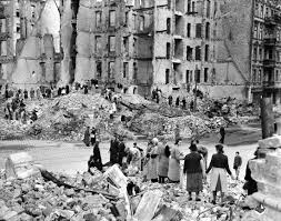 "German women, dubbed ""Trümmerfrauen"" (rubble women), work after a bombing."