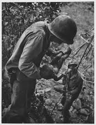 W. Eugene Smith | Wounded, Dying Infant Found by American Soldier in the  Saipan Mountains, June, 1944 (1944) | Artsy