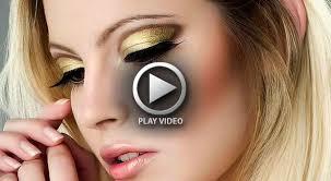 gold eye makeup with black eyeliner