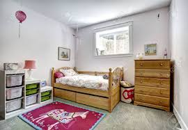Cozy Kids Room With Rustic Bed And Dresser Cheerful Red Rug Stock Photo Picture And Royalty Free Image Image 31616134