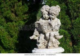 beautiful sculpture boy girl reading