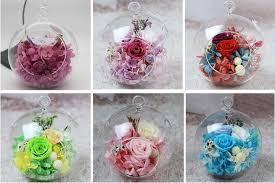 fresh preserved flowers in glass ball