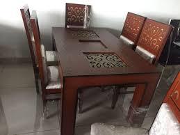 brown teak wood dining table warranty
