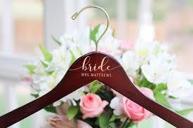 Amazon Com Yuunity Personalized Bridesmaid Hangers Wedding Hanger Wooden Engraved Hanger Bridal Dress Hanger Wedding Name Hangers Light Brown Home Kitchen