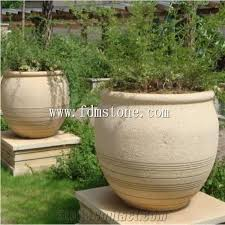 yellow stone planter flower pots garden