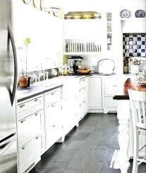 white kitchen cabinets grey floor