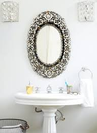 powder room with antique oval mirror