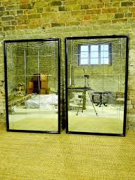 pair of large ebonised art deco mirrors
