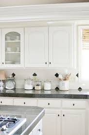 Peel And Stick Tile Backsplash Accents At The Picket Fence Laura Is Looking At This Kitchen Makeover Kitchen White Kitchen
